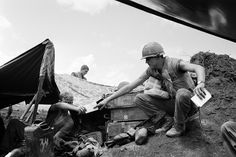 The address is muddy bunker and the mailman wears a flak vest as Cpl. Jesse D. Hittson of Levelland, Texas, reaches out for his mail at the U.S. Marine Con Thien outpost two miles south of the demilitarized zone in South Vietnam on Oct. 4, 1967.