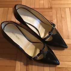Patent kitten heels Amazingly beautiful black patent pointy toed kitten heels. 2 1/2 inch heel. Some wear on bottom but otherwise perfect. Made in Italy and seriously comfortable. Perfect wardrobe staple. Bruno Magli Shoes Heels