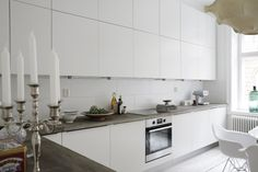 Clean white kitchen with concrete.