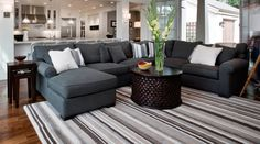 Love the charcoal gray sectional and cocktail table.