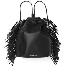 "Victoria's Secret Fashion Show Fringe Bag Official backpack from the 2015 Victoria's Secret fashion show. Black bag with fringe details on the sides. Silver logo. Cinch top. 16""L x 6.3""W x 14""H. New in original packaging, unused. Victoria's Secret Bags"