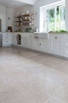 The Dijon tumbled limestone floor tiles add a truly classical English feel to a kitchen or bathroom. Order a free sample online today at Mandarin Stone! Stone Kitchen Floor, Kitchen Flooring, White Kitchen Floor Tiles, Foyer Flooring, Flooring Ideas, Mandarin Stone, Limestone Flooring, Travertine Floors, Natural Stone Flooring