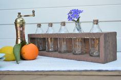Apothecary vintage glass bottle stand made from recycled wood. Comes with five glass bottles with cork stoppers. Scientific vibe. by WhoTheDickens on Etsy https://www.etsy.com/listing/197583852/apothecary-vintage-glass-bottle-stand