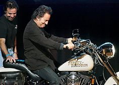 Bruce Springsteen with his Harley-Davidson before auctioned off the Harley for charity