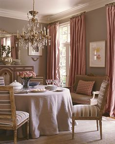 Suzanne Kasler dining room  like chandelier and curtains
