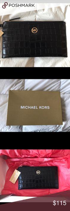Michael Kors Wristlets/clutch Brand new, NWT tags Michael kors bag. Black. Will come with Michael Kors box. *Price Firm* Michael Kors Bags Clutches & Wristlets