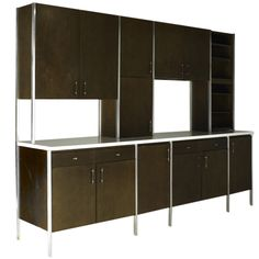 """A Rare Series 700 Wall Unit by Paul McCobb  USA  C. 1958  An incredible 1950's kitchen cabinet unit, designed to look like a built-in cabinet system for Modern open floor plan homes in the mid century. This section was part of a series of """"modular"""" cabinet pieces by Mutschler, allowing for homeowners and designers to create custom cabinet plans for each room of the home. This particular piece would have been used as a room divider, separating a kitchen from a living/dining room."""
