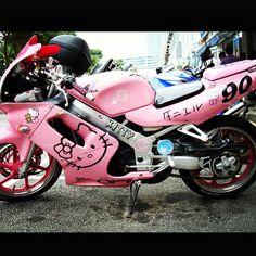 Oh my GOODNESS! Must Have THIS! Hello Kitty Pink Motorcycle!! :D