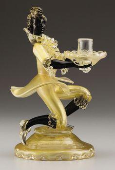 AN ITALIAN GLASS FIGURAL CANDLESTICK - Attributed to Salviati & Co., Murano, 1950's.