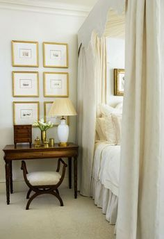 Golden frames, grand bed, white textiles and elegant furniture. A wonderful master bedroom.