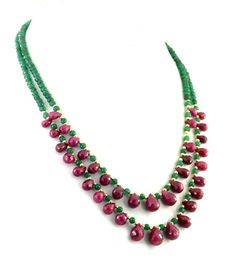 Two Row Emerald Necklace With Ruby Drops and Gold Foil Beads - Free Dangler Earrings ***************************************************************************************** *Use of Gemstone - Emeralds *Origin of Gemstone - Colombian *Length - 17-18 inches *Treatment - enhanced *clasp -