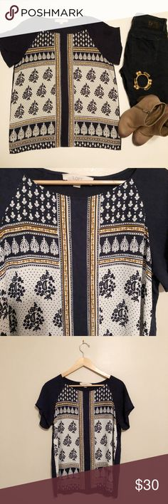 LOFT Navy and Gold patterned short sleeved blouse LOFT Navy and Gold patterned short sleeve blouse  This is a beautiful, flowy short-sleeved blouse that can be worn to work or on the weekends!  Colors are navy, ivory, and a golden-mustardy pop of color!  EUC  100% polyester LOFT Tops Blouses