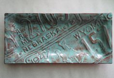Very cool license plate pottery and serving goods from Art-Shelf. Get them imprinted with any US State license plate