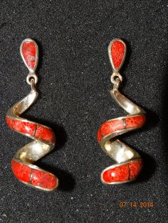 Hey, I found this really awesome Etsy listing at https://www.etsy.com/listing/196406513/vintage-swirl-dangle-sterling-silver