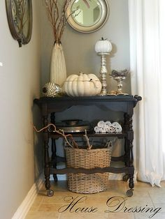 Love the table top arrangement with the basket underneath. My style!