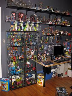 Large part of my collection. Vintage Real Ghostbusters, Masters of the Universe, Super Powers, Transformers, M.A.S.K., Thundercats, The Tick, G.I. Joe, Tron,     and a ton more. And my vintage Spider-Man and Pac-Man garbage cans :)