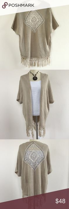 Crochet Fringe Cardigan Gorgeous open cardigan. Bohemian style, tan color with crochet square detail on the back. Fringe hem. Beautiful layering piece for spring and summer. One size, fits sizes small through large. Reminds me of something from Free People or Spell & The Gypsy Collective. Great condition   No trades No modeling No ️aypal No Merc ✅Posh Rules ✅Use Offer Button ✅Bundle for 15% off Sweaters