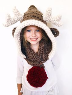 This whimsical hooded scarf is the perfect mix of cozy and cute. Available in three sizes, it brings warmth and a playful energy to any age from tiny tot to adult.With soft stuffed antlers and a red pom pom nose, Rudolph the Reindeer will be an instant favorite!Rudy the Reindeer features a fluffy pom pom tail on one end of the scarf and a loop closure on the other to keep the scarf closed.The hood features reindeer ears and soft stuffed antlers.This is an easy+ level crochet pattern. The…
