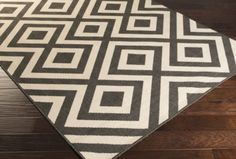 Rug runners for stairs - this black and natural geometric indoor outdoor runner would bring a fun punch to a set of stairs!