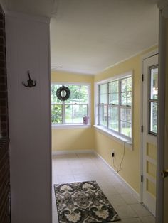Sun Room // Lively Yellow Behr Interior Satin + Ultra Pure White Behr Interior Satin Trim