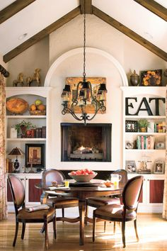 Raise the Fireplace - 79 Stylish Dining Room Ideas - Southernliving. This dining room fireplace is raised to table height so it can be enjoyed by everyone in the room.