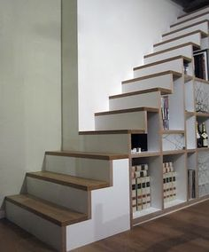 fantastic idea for a wine cellar / great use of basement stairs!
