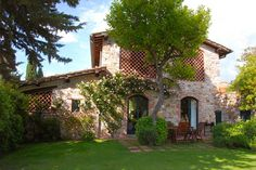 Lovely stone exterior, arched doorways, wood-screened patio