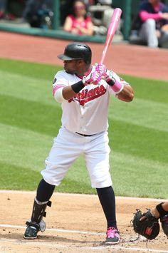 Carlos Santana uses a pink bat for Mother's Day and has his pants liked up high for the hot day during the game against the Minnesota Twins on May 10, 2015 at Progressive Field. (Chuck Crow/The Plain Dealer)