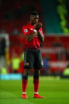 Paul Pogba of Manchester United prays at full time during the Premier League match between Manchester United and Huddersfield Town at Old Trafford on December 2018 in Manchester, United Kingdom. Get premium, high resolution news photos at Getty Images Paul Pogba Manchester United, Manchester United Players, Ronaldo Goals, Messi And Ronaldo, France Football, World Football, Pogba Wallpapers, Manchester United Wallpaper, Premier League Champions