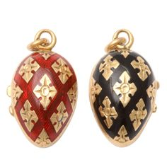 Gem red and black enamel contrast with gleaming 18kt gold in fraternal twin mini lockets, beautifully made with geometric cross hatching and delicious in design. The inner surface is vivid in peacock blue. Framed crystal inside for mementos. You see French workmanship to perfection in these small treasures. Circa 1870.
