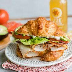 An easy recipe for a Turkey Avocado BLT Croissant Sandwich. Make this delicious Red Robin copycat at home with flaky, buttery croissants, lots of bacon, juicy tomatoes, and as much avocado as you want! Your new favorite lunch. Croissant Sandwich, Bagel Sandwich, Dinner Sandwiches, Gourmet Sandwiches, Cold Sandwiches, Club Sandwich Recipes, Lunch Recipes, Breakfast Recipes, Cooking Recipes