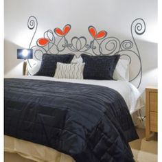 vinilo-decoracion-cabecero-corazon-cama-pared