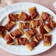 Holiday Bacon Appetizers 1 pkg. country club-style crackers ¾ c. grated Parmesan 1 lb.thinly sliced bacon                   Lay crackers face up on large rack over baking sheet (or broiler pan). Scoop about 1 tsp. of cheese onto @ cracker. Cut the pkg. of bacon in half & wrap @ cracker with 1/2 piece of bacon, completely covering the cracker. Place on rack; place baking sheet in the oven (250) for about 2 hrs. Serve immed. or at room temp.  Can also use br. sugar  instead of Parmesan.