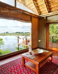 Lagoon Camp - Linyanti - Botswana Safaris. Lagoon is perched on the banks of the wild Kwando River, overlooking the Mudumu National Park in the Namibian Caprivi Strip. The camp is nestled beneath towering ebony and marula trees and accommodates up to 16 guests in eight traditionally styled 'tents.'