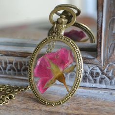 Real Rose Bud Necklace in Resin in large bronze oval - Handmade Flower Jewellery