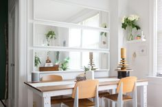 """""""I am obsessed with having enough light in my home. I'm on the second floor, so it isn't as bright in here as I would like. My quick solve for that was to create the illusion of more windows with this wall of mirrors."""" These are three floor-length IKEA Nissedal mirrors, turned sideways."""