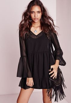 Up your day game in this black chiffon swing dress. With bell sleeve and frill bottom features this dress is seriously on point and will ensure all eyes are on you. Style with some heeled ankle boots for a flawless finish to your look.   ...