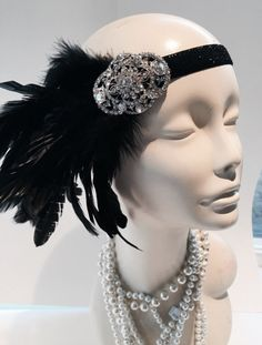 New Years Eve-Black feather Headpiece- Feather 20s Head wrap -great Gatsby -1920 hair accessory- Handmade in USA- Halloween costume headwrap  Hello, This black feather head wrap is made with black Coque feathers.  The rhinestone and glass piece measures about 2inches long and the feathers are 5 -6 inches wide.  Rhinestones piece: Flower Oval Sun burst They are placed on a 5/8 inch stretch band that fits any adult head size and very comfortable. Stretch Band colors ... Black Navy Silver G...