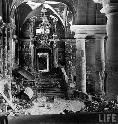 Interior of the Reichstag building showing destruction as well as graffiti scrawled & scratched on the walls by conquering Russian soldiers