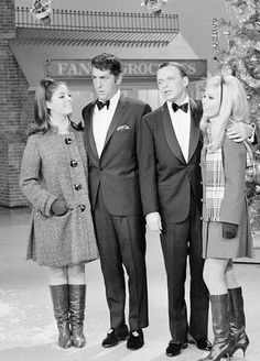 "Dean Martin and Frank Sinatra perform with daughters Gail Martin and Nancy Sinatra on ""The Dean Martin Show's"" 1967 Christmas special"