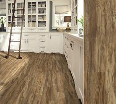 -LVT this is vinyl... How cool is that!  Shaw Array luxury vinyl plank in style Aviator Plank, color Maverick Brown.