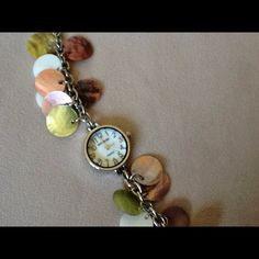 "ON SALE!!   Rumours Watch So cute, especially for summer with the multi-colored shell discs.  End to end measures 7"". Rumours Jewelry"
