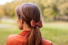 This rosewood hair bow. | 24 Wooden Accessories To Bring You Closer To Nature