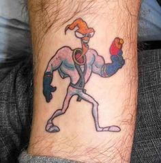 The only thing this Earthworm Jim tattoo is missing is his companion, Peter Puppy. | 21 Epically Nostalgic '90s Cartoons As Tattoos