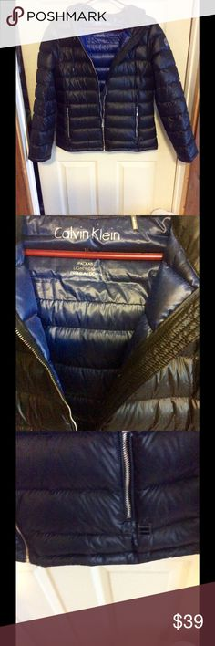 Black Calvin Klein lightweight down This is down but it's a lightweight one good for upcoming spring I wore it about a week ago and froze so not good for under 35 40 degrees it has a tiny hole on sleeve but I'll fix it you'll never know royal blue lining which is nice have bag Calvin Klein Jackets & Coats Puffers