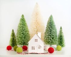 Turn this DIY Putz House Ornament Kit into a beautiful Christmas decoration with a few craft supplies & your own creative touch! Make one for