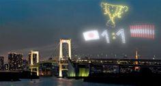 東京上空にドローンの光で情報を浮かび上がらせる(イメージ)=NTT提供