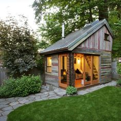 This charming [154-square-foot] backyard retreat, constructed in less than six months, used salvaged lumber from three Oregon barns, a salvaged copper roof, natural plaster walls and a wood stove. The loft support is exposed, underlining a desire to showcase the beauty of the structural elements.