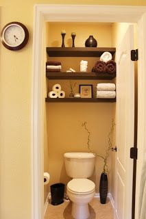 totally doing this in my master bathroom .....wall to wall shelves behind toilet that's in a small nook. i like that they're fairly high on the wall.