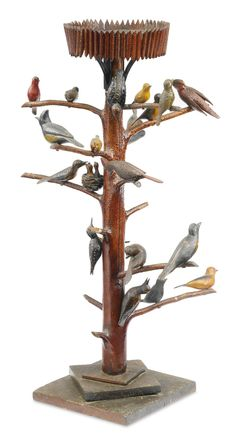 """LOT SOLD. $25,000 USD  Rare Carved and Painted Pine Twenty-Three Bird """"Adirondack-Style"""" Bird Tree, Probably New York State circa 1900   Height with base 37 1/2 inches; Width of base 12 inches; Diameter overall 22 inches Visual Grace: Important American Folk Art from the Collection of Ralph O. Esmerian"""